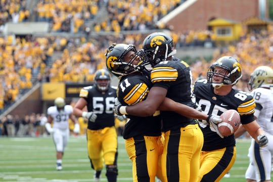 Kevonte Martin-Manley (11), who would eventually become Iowa's all-time leader in receptions, celebrates his game-winning touchdown against Pittsburgh in 2011 with teammates Keenan Davis (6) and Zach Derby (85).
