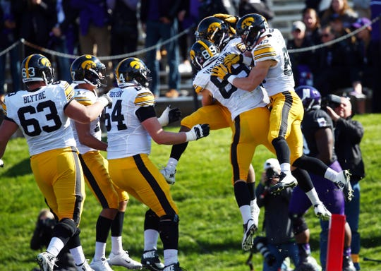 Akrum Wadley is mobbed by teammates after scoring one of his four touchdowns in Evanston in 2015, an unexpected blowout of a ranked Northwestern team that set the table for an undefeated regular season.