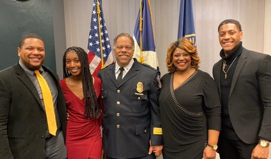 Randal Taylor, center, poses for a photo with his wife and children after he was sworn in as Indianapolis Metropolitan Police Chief. From left: Austin, 27; Nia, 18; and Quentin, 24.
