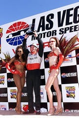 """Sam Schmidt had grown out his sideburns and was given the nickname """"Elvis"""" by fellow drivers."""