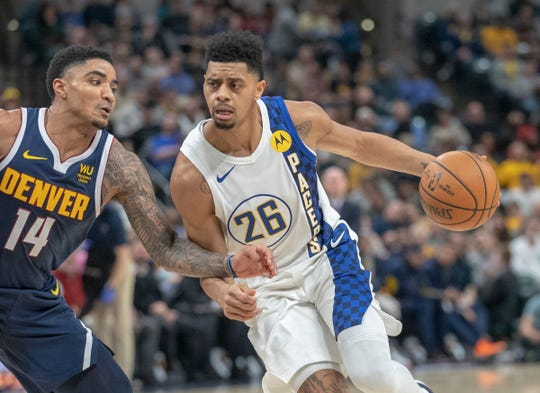 Jeremy Lamb of the Indiana Pacers drives on Gary Harris of the Denver Nuggets, Denver Nuggets at Indiana Pacers, Bankers Life Fieldhouse, Indianapolis, Thursday, Jan. 2, 2020.