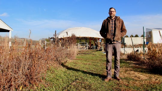 Dorsey stands at the Butler University farm, which produces almost 10,000 pounds of produce yearly.