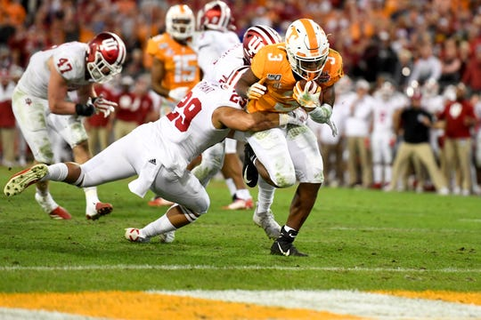 Tennessee Volunteers running back Eric Gray (3) runs the ball in for a touchdown against Indiana Hoosiers defensive back Khalil Bryant (29) during the fourth quarter at TIAA Bank Field.