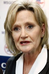U.S. Sen. Cindy Hyde-Smith, R-Miss., speaks about her upcoming bid for re-election at state Republican party headquarters in Jackson, Miss., Friday, Jan. 3, 2020, after filing papers to seek re-election. She is expected to campaign by emphasizing her loyalty to President Donald Trump. (AP Photo/Rogelio V. Solis)