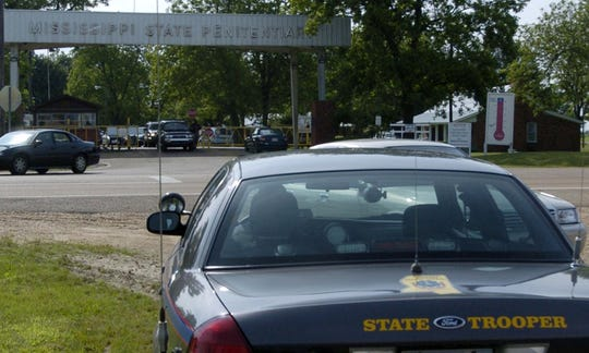 This file photo shows a Mississippi Highway Safety Patrol trooper waiting by the front entrance to the Mississippi State Penitentiary at Parchman.