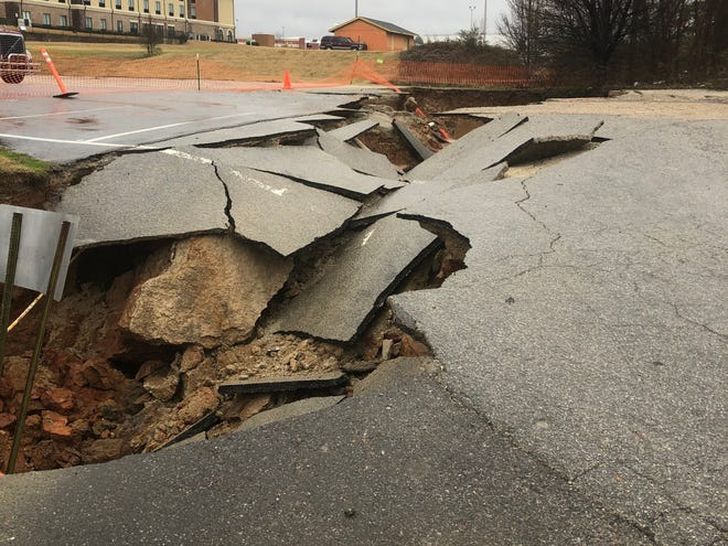 Part of Casey Jones Lane in Jackson, Tenn. was closed Thursday afternoon after the roadway caved in. Old Country Store and the Casey Jones Village are still open and accessible through the parking lot entrance near the train museum.