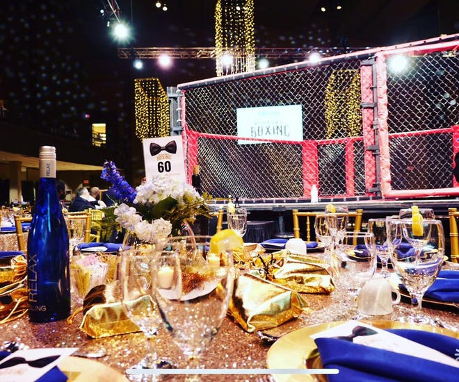 Tables surround the MMA boxing ring at the 2019 Black Tie and Boxing charity event. This year's fourth annual event will be Saturday, Jan. 4 at the Carl Perkins Civic Center.
