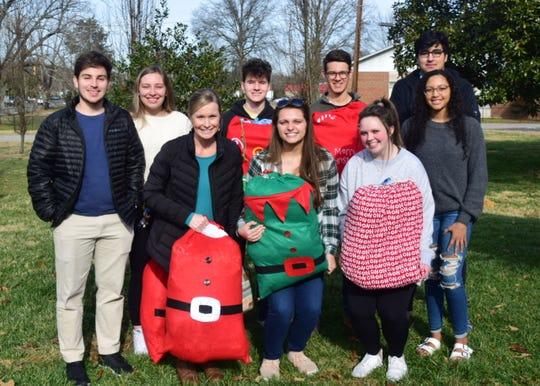Several Karns High School DECA students met at Autumn Care Assisted Living to distribute homemade blankets Friday, Dec. 20. From left, front: DECA adviser Cynthia Rhoden; Mikayla Miles, 18; Rheagan Haynes, 17; Jadyn Jones, 16; back, Alen Nukic, 18; Emily Engel, 17; Sam Pinkston, 16; Caleb Foster, 17; and Haitham Rghebi, 17.