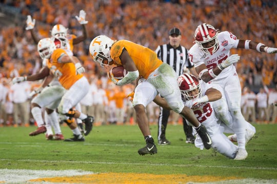 Tennessee running back Eric Gray (3) runs into the end zone for a touchdown during the Gator Bowl game between Tennessee and Indiana at the TIAA Bank Field in Jacksonville, Fla., Jan. 2, 2020. The vols defeated Indiana 23-22.
