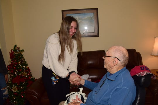 Karns High School DECA club member Emily Engel, 17, shakes hands with Fred Pardue at Autumn Care Assisted Living on Friday, Dec. 20, 2019.