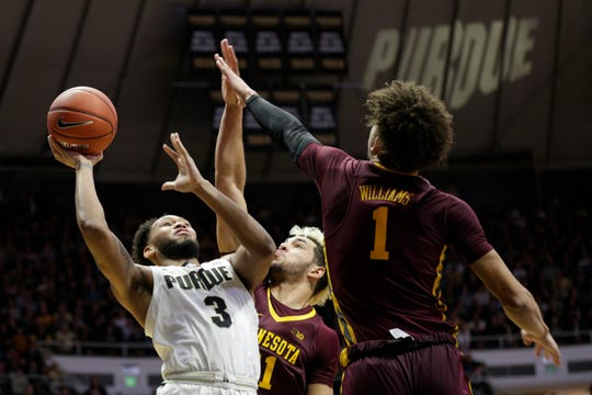 Purdue guard Jahaad Proctor (3) goes up for two against Minnesota forward Jarvis Omersa (21) during the second half of a NCAA men's basketball game, Thursday, Jan. 2, 2020 at Mackey Arena in West Lafayette.