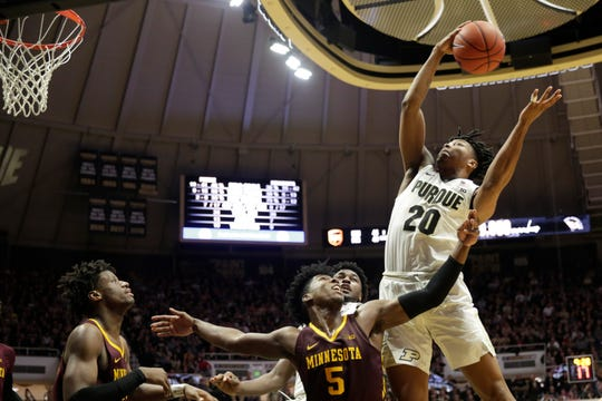 Purdue guard Nojel Eastern (20) goes up for the rebound over Minnesota guard Marcus Carr (5) during the second half of a NCAA men's basketball game, Thursday, Jan. 2, 2020 at Mackey Arena in West Lafayette.