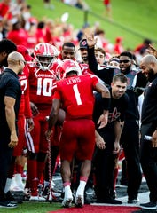 UL quarterback Levi Lewis celebrates a touchdown with the team's baller baton during a win over Liberty earlier this season.