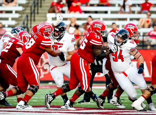 UL offensive guard Kevin Dotson (75) blocks during a win over Liberty earlier this season.