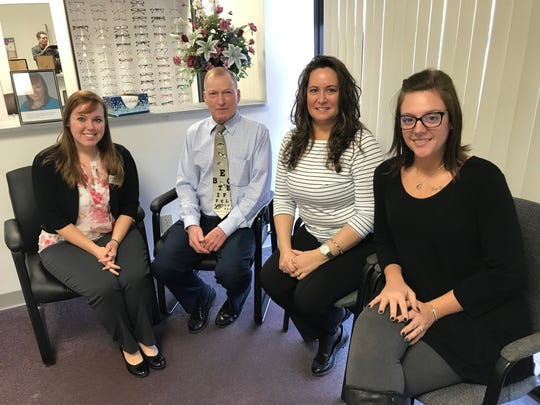 Dr. Ashley Hughes (left) recently purchased the optometry practice of Dr. Robert Kreuter (second from left), who plans to work part-time for her until the summer or fall before fully retiring. Also pictured is practice manager Angie Stiverson (second from right) and technician Tosh Nethers (right). The office is located at 1222 N. Memorial Drive.