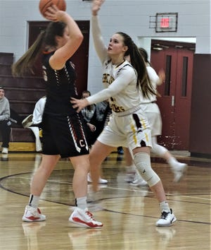 Berne Union's Baylee Mirgon applies defensive pressure against Trimble during the Rockets' 50-49 nonconference loss Thursday night.
