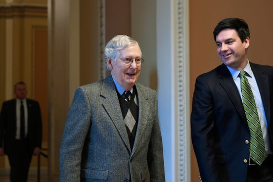 Senate Majority Leader Mitch McConnell arrives on Capitol Hill in Washington on Friday.