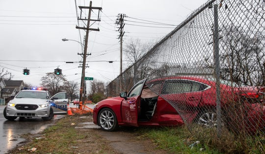 A car sits entangled in a fence at 30th and Muhammad Ali following a police chase involving a separate vehicle.