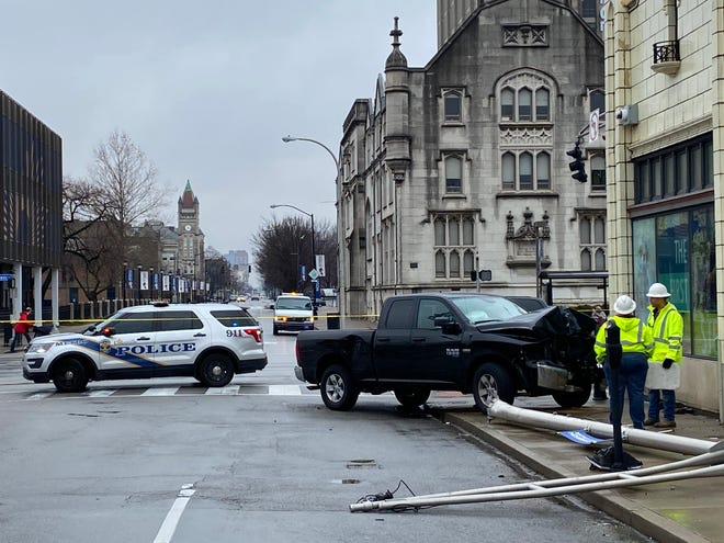 A Dodge Ram crashed into a stoplight pole at First Street and Broadway on Friday after a police chase.