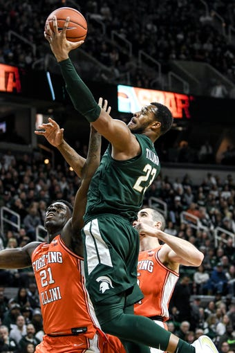 Michigan State's Xavier Tillman, right, scores on a layup as Illinois' Kofi Cockburn defends during the first half on Thursday, Jan. 2, 2020, at the Breslin Center in East Lansing.