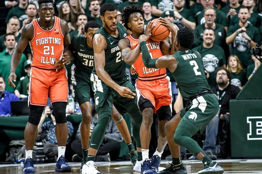 Michigan State's Xavier Tillman, left, and Rocket Watts, right, pressure Illinois' Ayo Dosunmu during the first half on Thursday, Jan. 2, 2020, at the Breslin Center in East Lansing.