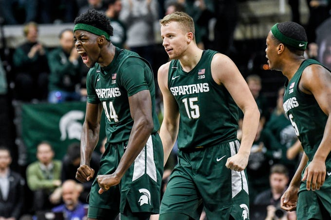 Michigan State's Gabe Brown, left, celebrates his 3-poiner with Thomas Kithier, center, and Cassius Winston during the second half on Thursday, Jan. 2, 2020, at the Breslin Center in East Lansing.