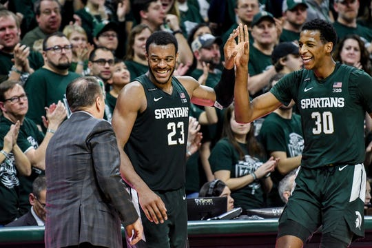 Michigan State's Xavier Tillman, center, and Marcus Bingham Jr., right, talk with head coach Tom Izzo late during the second half on Thursday, Jan. 2, 2020, at the Breslin Center in East Lansing.