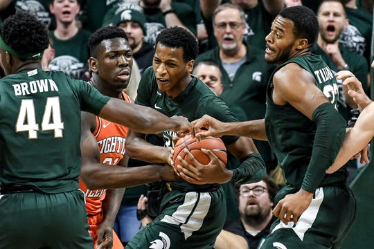 Michigan State's Marcus Bingham Jr., center, grabs a rebound during the first half on Thursday, Jan. 2, 2020, at the Breslin Center in East Lansing.