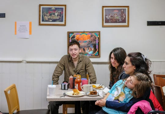"""St. Johns residents Steve Dunlap, left, Charli Langlois, Clarissa Czubak and her daughter, Dilana, 5, are surprised to learn their meal has been paid for by people who have previously visited Dershey's Cafe in St. Johns and wanted to """"pay it forward"""" Friday, Jan. 3, 2020."""