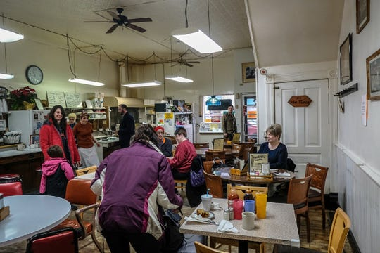 """Customers at Dershey's Cafe in St. Johns are happy to have a meal paid for through a """"pay it forward"""" campaign Friday, Jan. 3, 2020."""