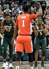 Michigan State's Xavier Tillman, left, and Cassius Winston clap after Tillman scored during the first half on Thursday, Jan. 2, 2020, at the Breslin Center in East Lansing.