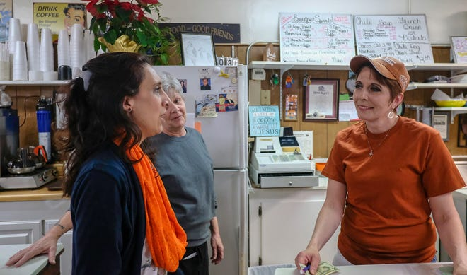 """Clarissa Czubak, a St. Johns resident and business owner of a Reiki Practice and metaphysical shop takes the time to express her thanks to Carrie Lockwood, center, and Dianne Smith at Dershey's Cafe in St. Johns carry-on a """"pay it forward"""" campaign that started December 20th and has continued on through donations from customers. Over 160 people have had their meals paid for mostly by customers who learn what's going on. Friday, Jan. 3, 2020."""