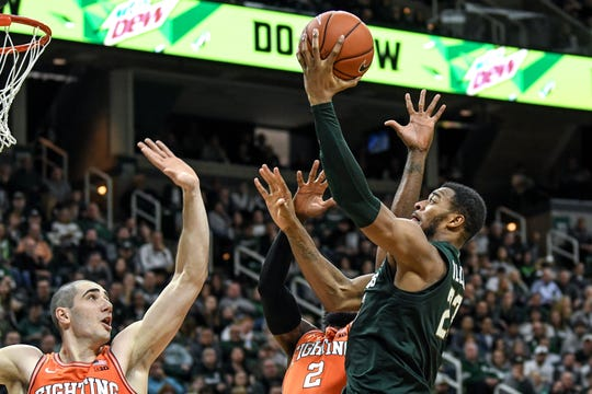Michigan State's Xavier Tillman, right, shoots a layup as Illinois' Giorgi Bezhanishvili, left, and Kipper Nichols defend during the second half on Thursday, Jan. 2, 2020, at the Breslin Center in East Lansing.