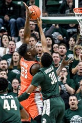 Michigan State's Marcus Bingham Jr., right, blocks a shot by Illinois' Kofi Cockburn during the first half on Thursday, Jan. 2, 2020, at the Breslin Center in East Lansing.