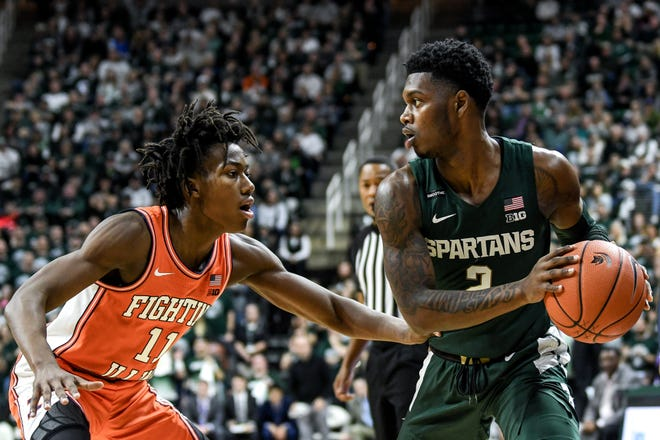 Illinois guard Ayo Dosunmu, left, is averaging 21.2 point, 6.2 rebounds and 5.3 assists per game. Rocket Watts, right, will likely spend some of the night trying to slow Dosunmu.