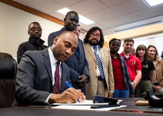 Shelby County Mayor Lee Harris signs a ceremonial copy of the letter to the federal government indicating that the county would continue its participation in the U.S. Refugee Resettlement Program on Jan. 3, 2020