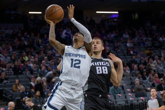 Memphis Grizzlies guard Ja Morant (12) shoots as Sacramento Kings forward Nemanja Bjelica (88) defends during the second half of an NBA basketball game in Sacramento, Calif., Thursday, Jan. 2, 2020. The Kings won 128-123. (AP Photo/Randall Benton)