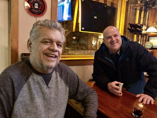 Mike Romans, left, will sit on the visitor side of his Romans' Pub while being treated for cancer and Charcot-Marie-Tooth disease. Champps Americana owner Tony Lewanovich, right, is one of several in Milwaukee's beer community planning a benefit for Romans.