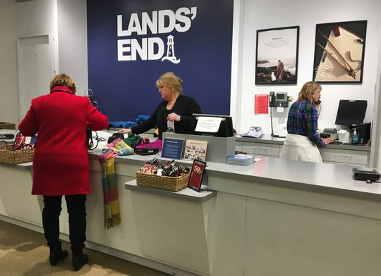A customer checks out at Land's End at the Riverpoint Village Shopping Center in Fox Point. Lands' End is expanding its small fleet of standalone stores.