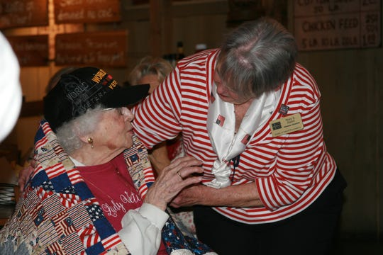 World War II veteran Edith Mitchell (left) celebrated her 98th birthday last week with members of the North Central Arkansas Military Service Sisters and received a quilt from the Mountain Home Quilts of Valor. With Mitchell is Group Leader Mary E. Hazel of Mountain Home Quilts of Valor.