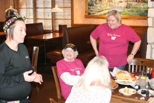 World War II veteran Edith Mitchell (sitting) was honored by members of the North Central Arkansas Military Service Sisters, a social group started by Flippin resident Elesha Granniss (right). The group is for female veterans meets monthly for lunch at area restaurants.