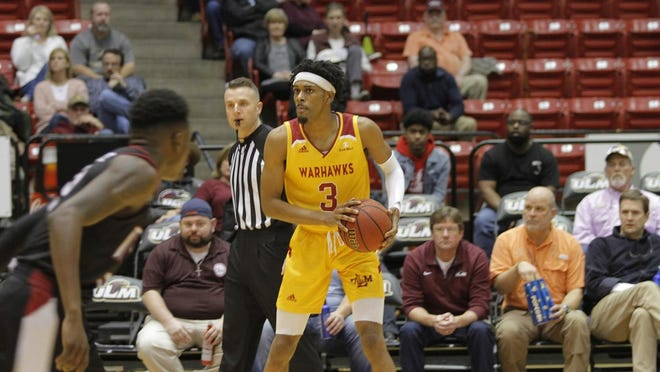 ULM guard JD Williams looks to pass in ULM's 79-63 win over Troy on Thursday night at Fant-Ewing Coliseum.