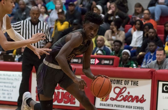 Simsboro's Jakemin Abney (14) averaged 23 points during his senior season. The back-to-back Class B state champions fell short of a three-peat in this year's finals.