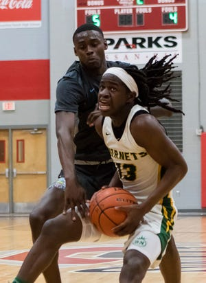 Rayville's Damerion Williams (13) protects the ball during the Don Redden Memorial Classic at Ouachita Parish High School. Williams scored a game-high 23 points against Clinton.