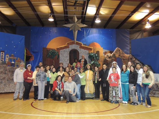 Volunteers for the Morris County Organization for Hispanic Affairs pose for a picture during their 2013 Three Kings Day Celebration.