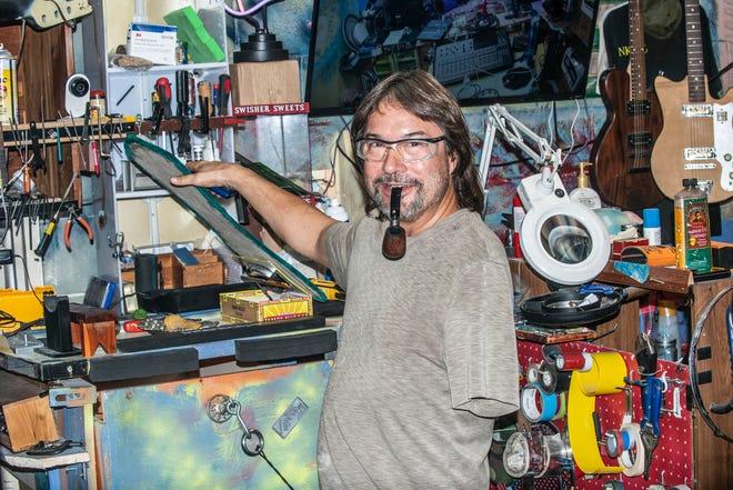 Lance Lisenby shows off his guitar workshop at Lisenby's Music Shop in Prattville.