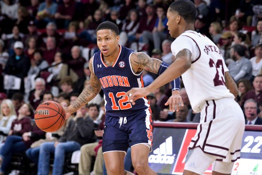 Auburn guard J'Von McCormick (12) handles the ball while being defended by Mississippi State guard Tyson Carter (23) at Humphrey Coliseum on Jan. 26, 2019, in Starkville, MS.