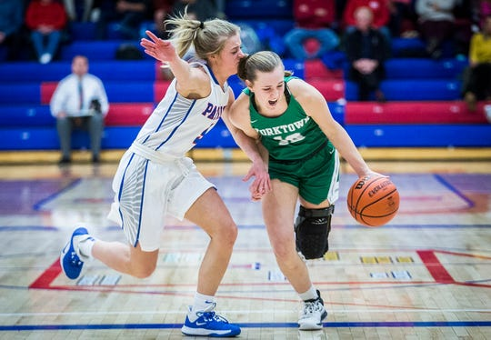 FILE -- Yorktown's Carley Culberson powers past Jay County's defense during their game at Jay County High School Thursday, Jan. 2, 2020.