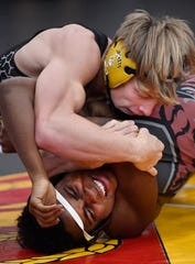 Riley Bennett (Fairview) and Alton Cates (Overton) struggle with each other at the Johnny Drennan '85 Memorial Invitational at Father Ryan  in Nashville, Tenn. Friday, Jan. 3, 2020.