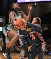 Vanderbilt guard Demi Washington (12) shot is blocks by Auburn guard Morgan Robinson-Nwagwu (30) during a game  at Memorial Gym in Nashville on Thursday, Jan. 2, 2020.